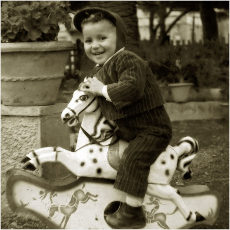 My dad on a toy horse, circa 1954