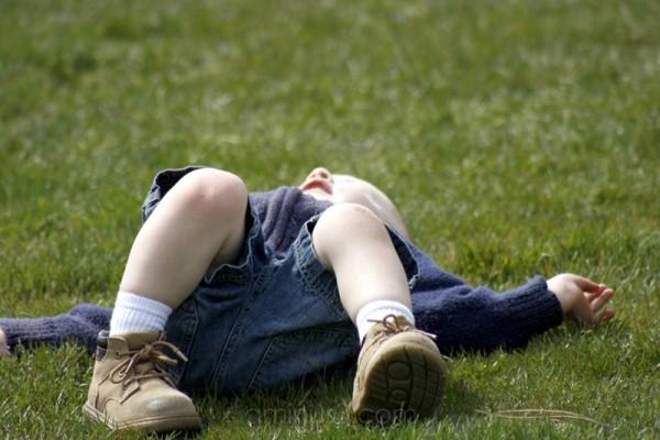 John lying down at play