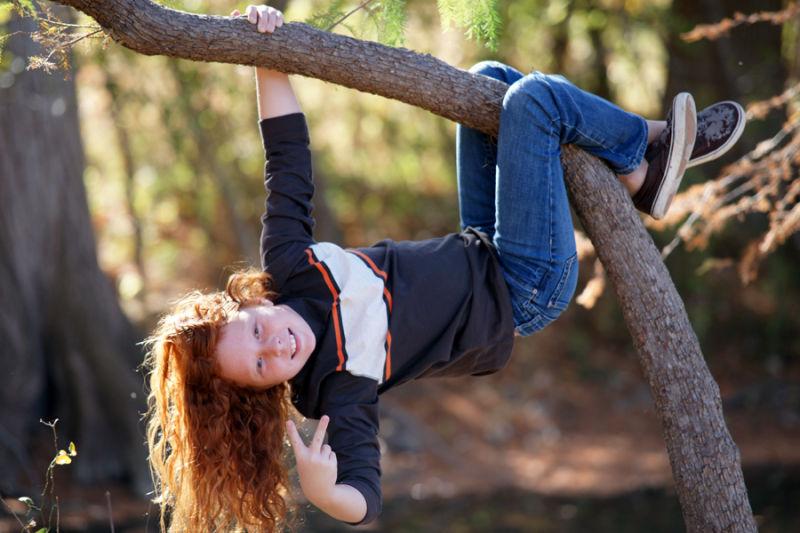 Meagan hanging in tree