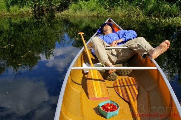 canoe paddler takes a break