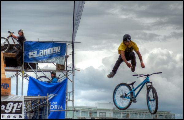 dirt jump biker flying high