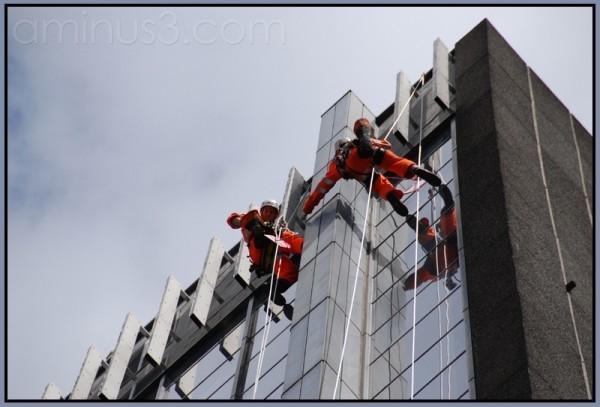 London window-cleaners climbing