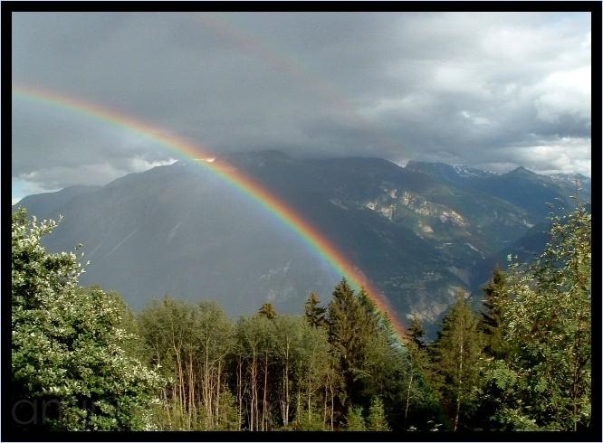 rainbow switzerland valais mountains crans montana