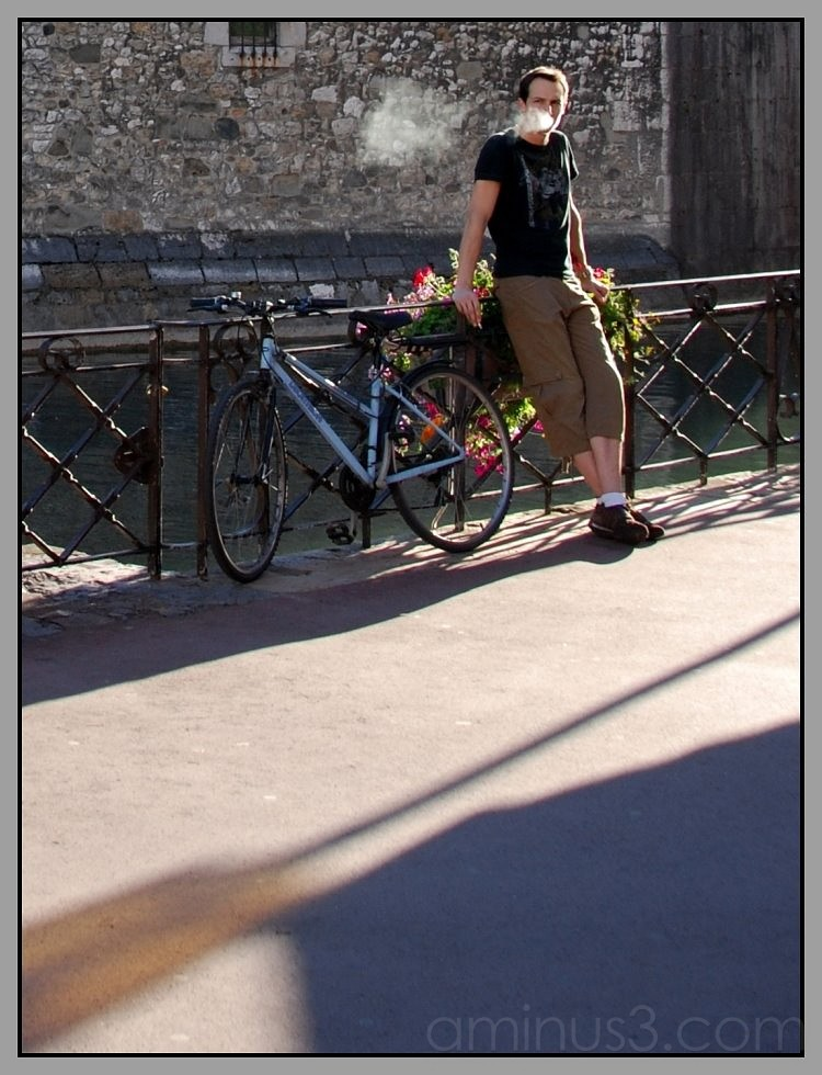 young man smoking in Annecy