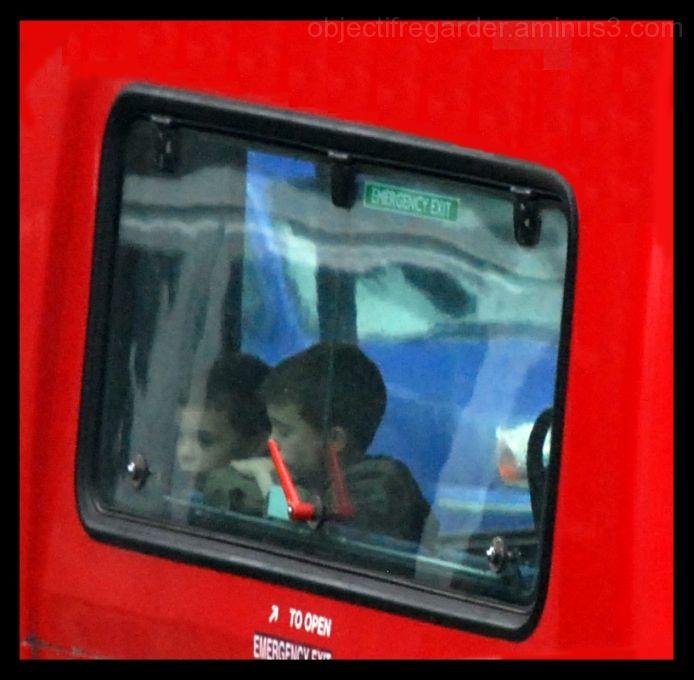 twi little boys in a london bus