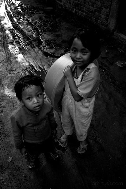 Friends on a muddy street