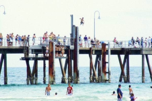 teenager jumping from jetty glenelg australia
