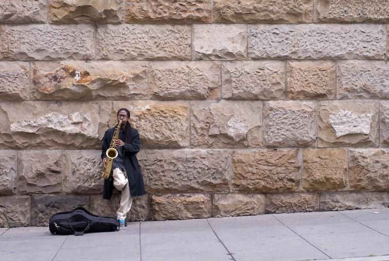 street musician playing saxophone