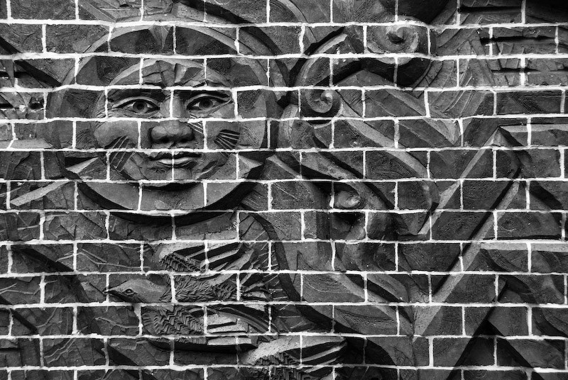 sculpture in brick wall