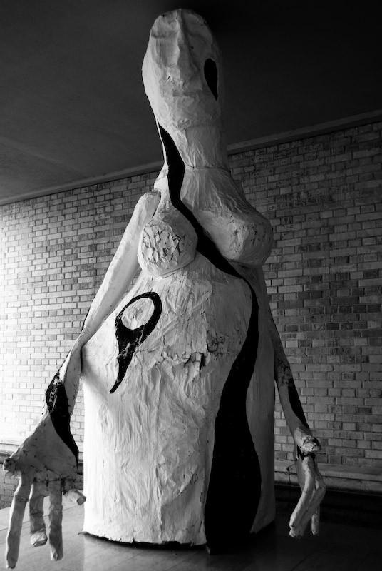 black and white creepy statue