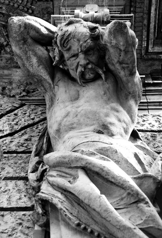 statue under balcony in budapest