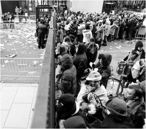 crowd of people behind a cage