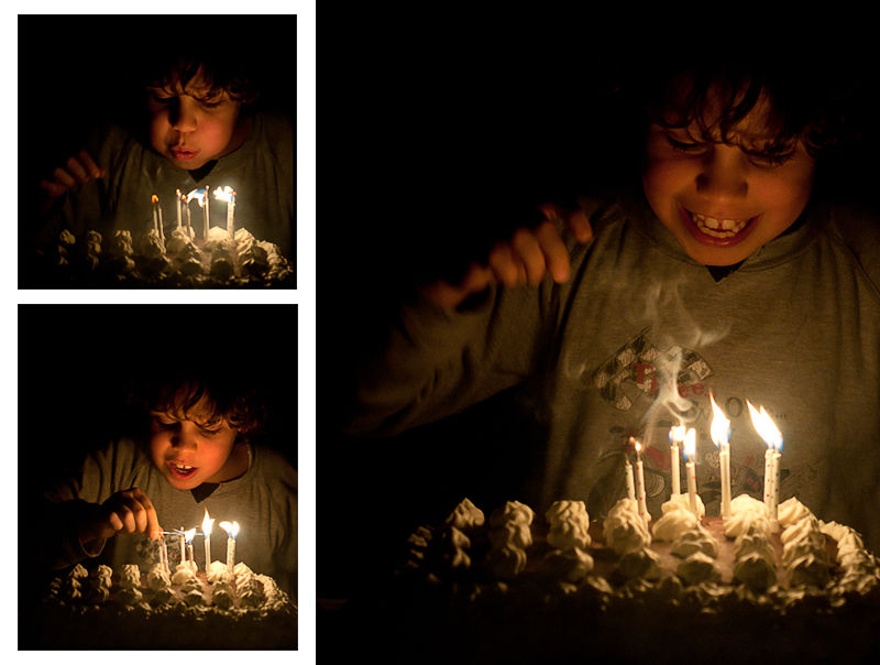 child is blowing out birthday candles