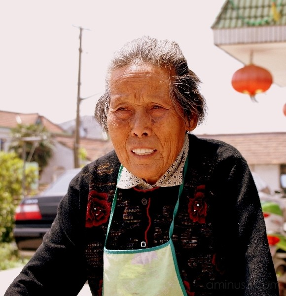 old woman in countryside