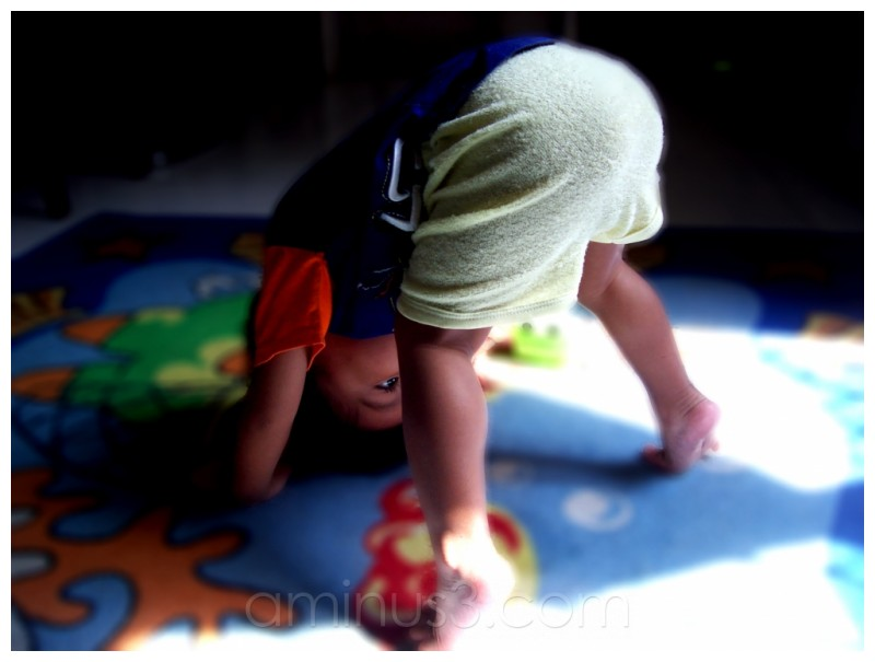 child, up side down