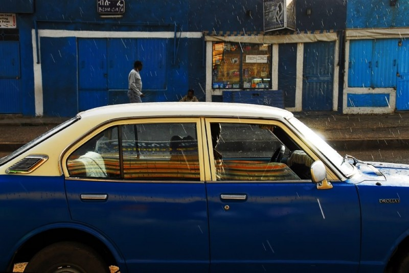 Taxidriver in a street of Addis-Ababa Ethiopia
