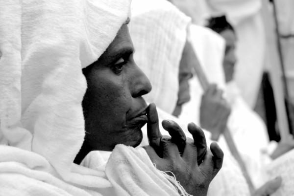 Ethiopian woman praying during Timkat, Ethiopia