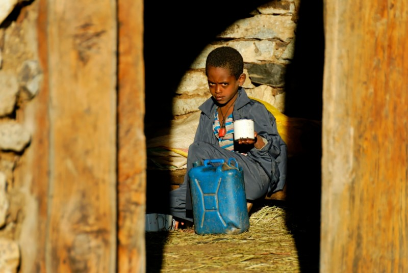 Children preparing tea, Ankober, Ethiopia