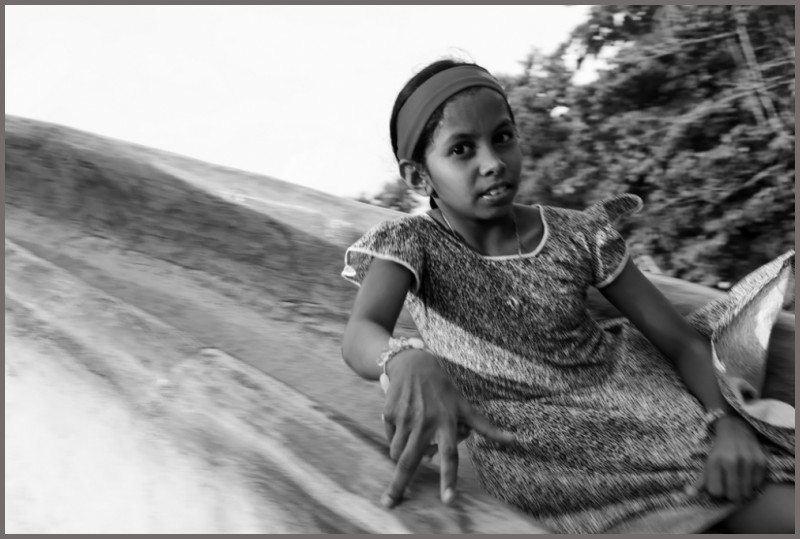 Girl on a toboggan, Colombo, Sri-Lanka