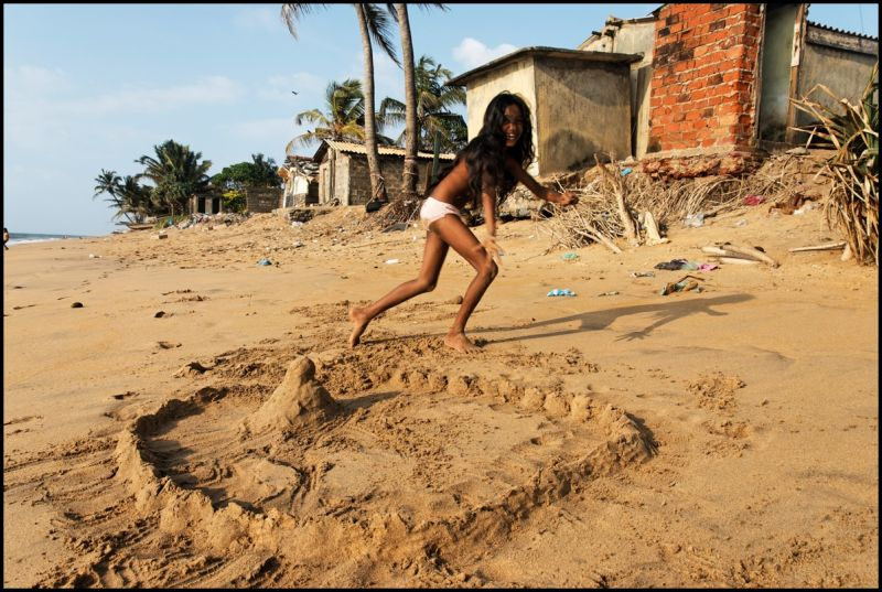 Child playing on Mount-Lavinia beach, Sri Lanka