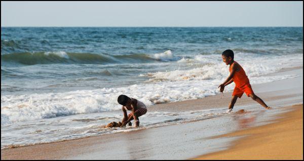 Kids playing on Mount Lavinia beach, Sri Lanka