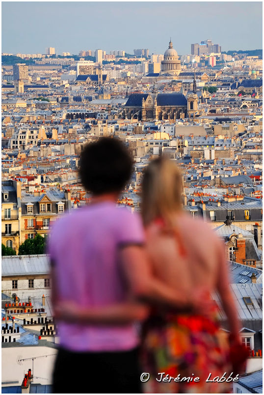 Tourists looking at Paris from Montmartre