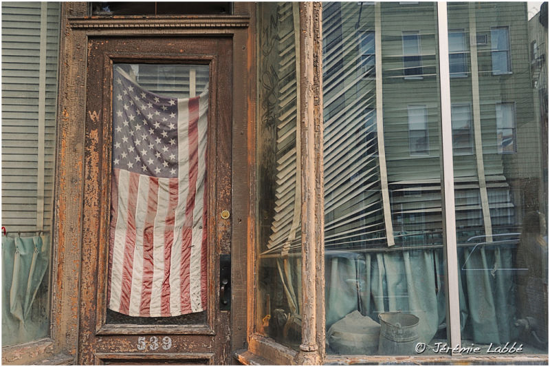 US flag in a shop window, New York.
