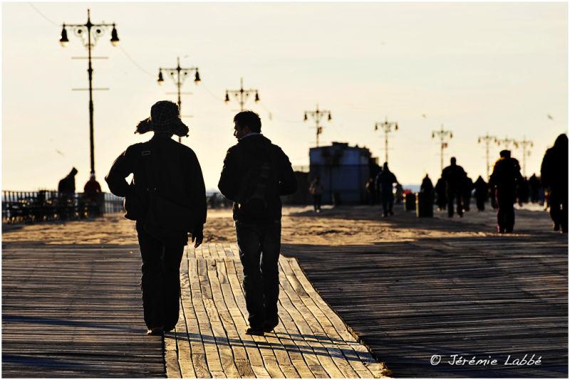Pedestrian on Coney Island promenade, New York