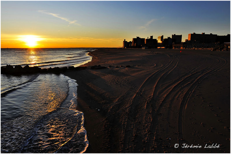 Sunset on Coney Island's beach, New York