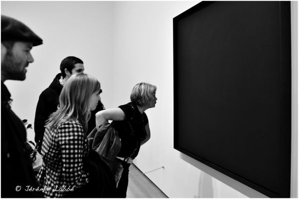 People watching a painting at MoMA, New York