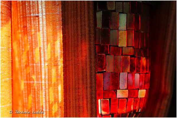Oriental lamp and curtains lit by sunlight