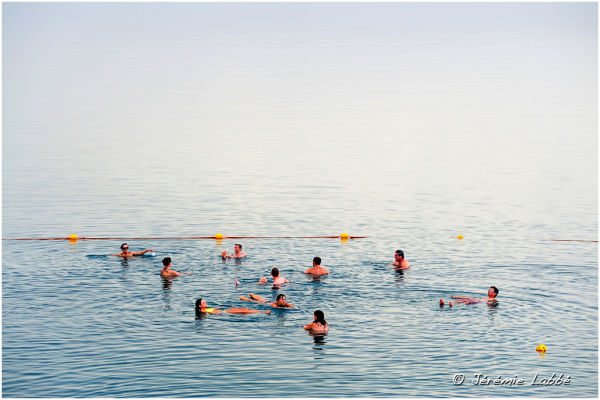 Group of tourists in Dead Sea, Jordan