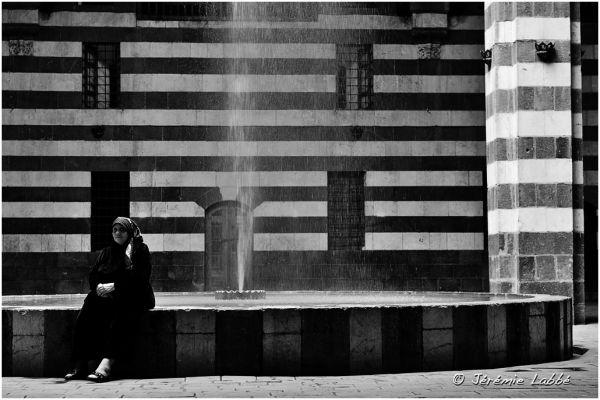 Women sitting near a fountain, Damascus, Syria