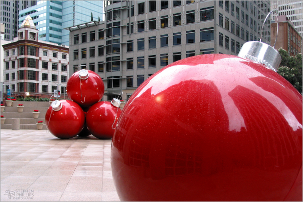 Giant Christmas orniments at 101 California Street