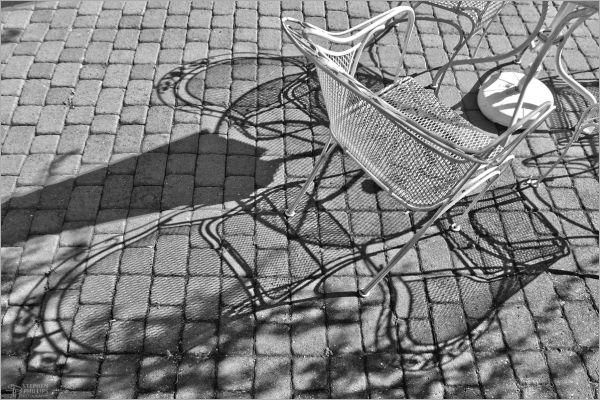 patio furnature shadows upon brick patio