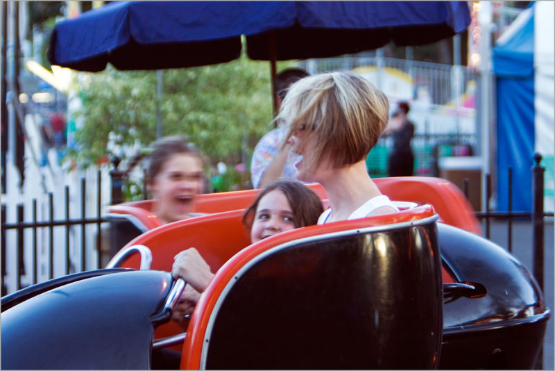 girls in an amusement park on a spin