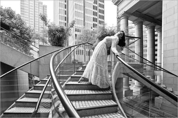 woman on a stairway in a gunne sax dress