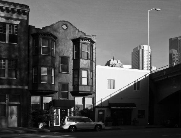 shadow across the urban street scene