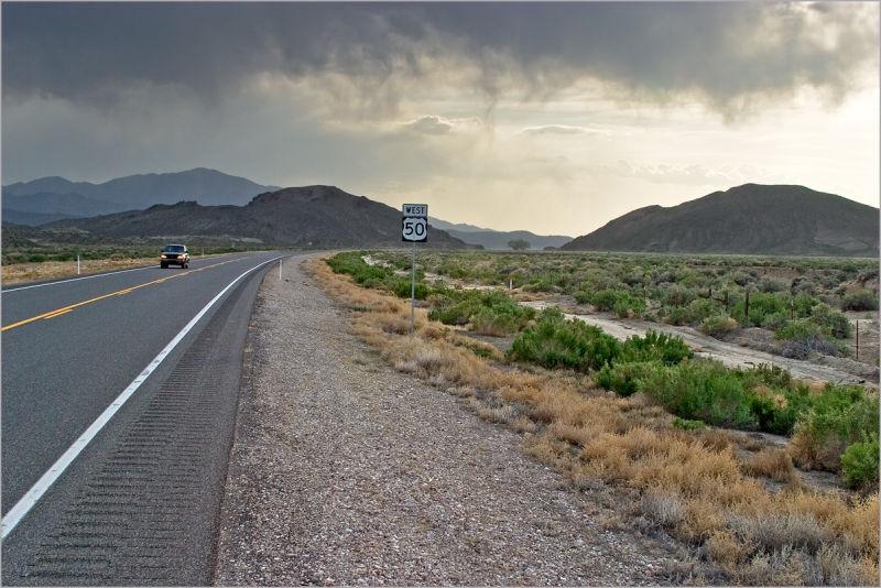 Nevada U.S.50 highway storm clouds mountain range