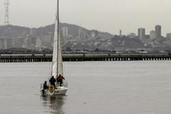Sailboat & crew departing the Berkeley Marina