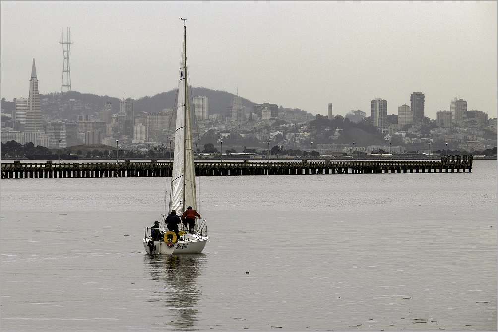 Sailboat & crew departing the Berkeley Marina