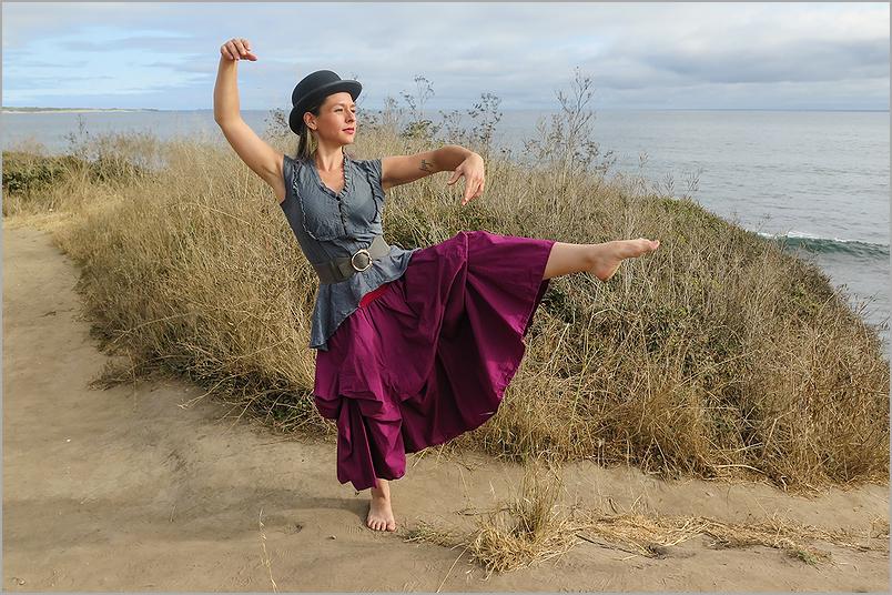 Model dancing along the Pacific Ocean dunes