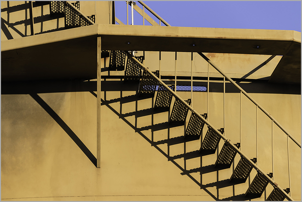 Stairway along a storage tank on the waterfront