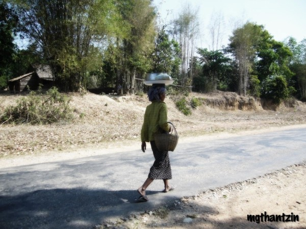 Old Burmese woman on the highway
