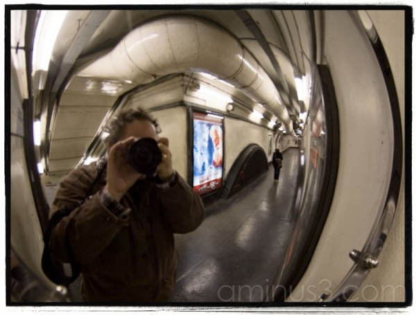 Self-portrait in fish-eyed mirror