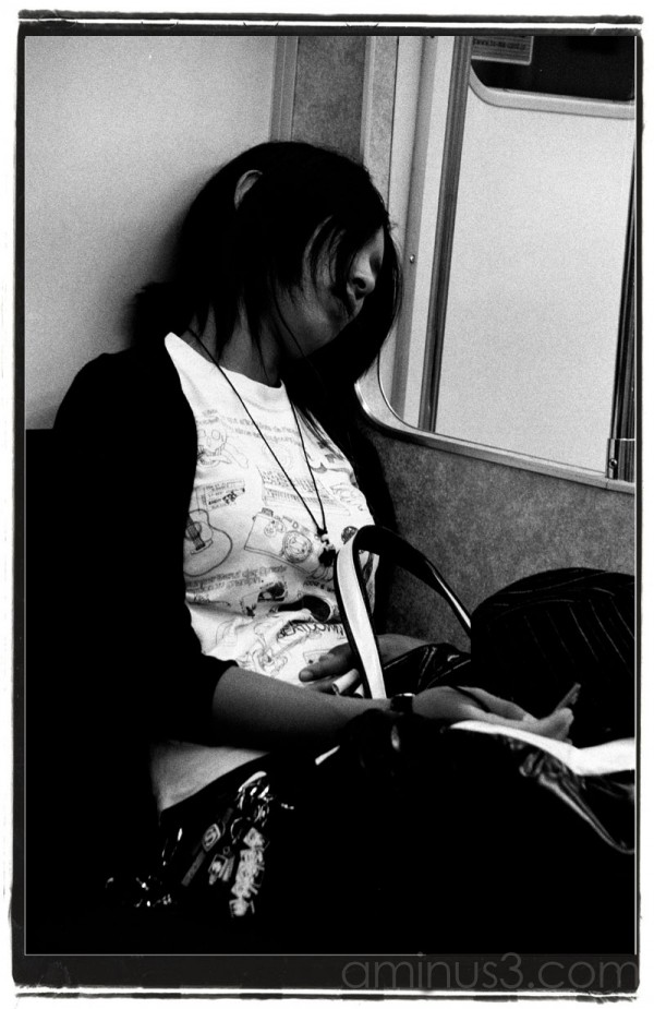 Girl asleep on train