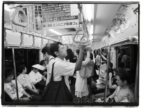 Japanese people on a subway train