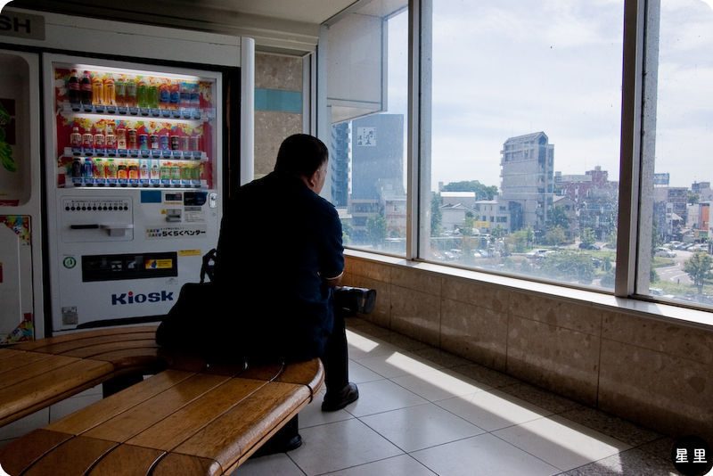 Salaryman waiting for next appointment