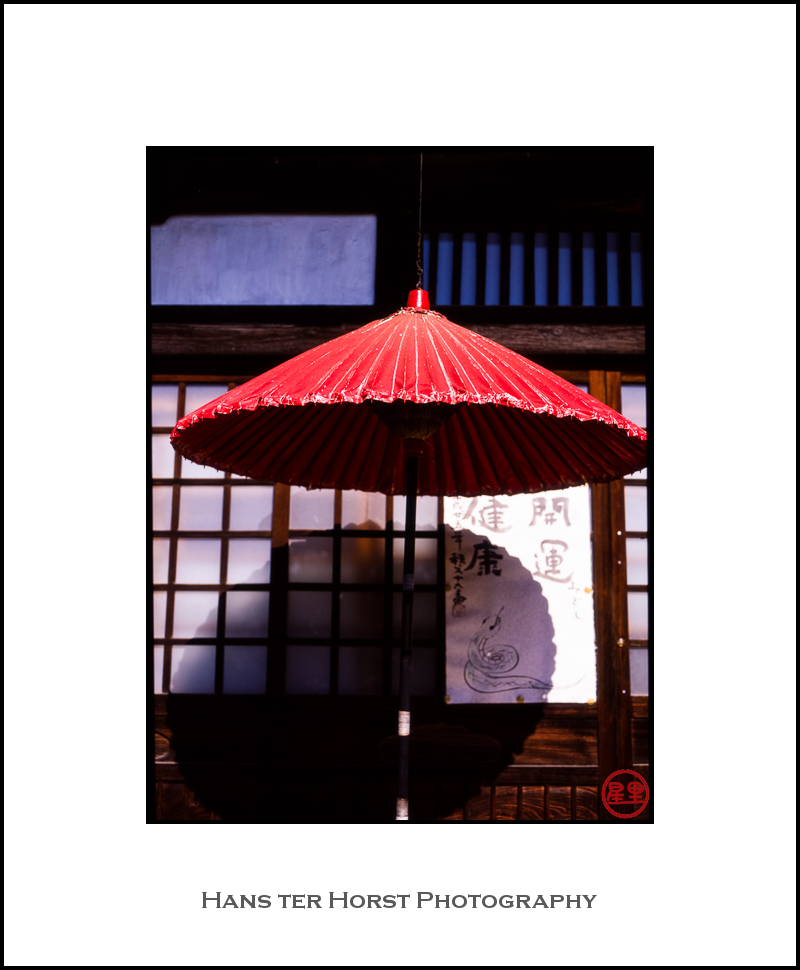 Red paper umbrella at a temple