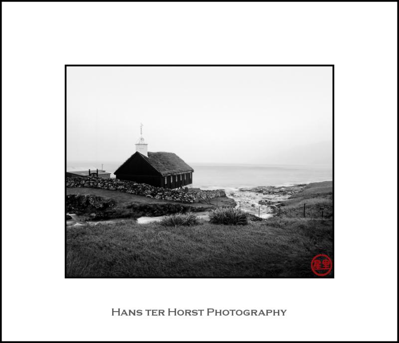 Faroe: church of Funningur in the storm
